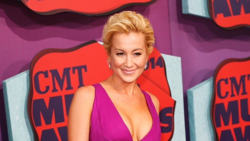 June 4, 2014. Musician  Kellie Pickler arrives at the 2014 CMT Music Awards in Nashville, Tennessee.