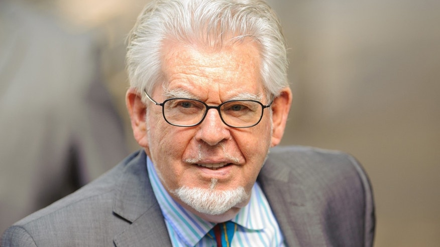 June 30, 2014. Veteran entertainer Rolf Harris arrives at Southwark Crown Court in London.