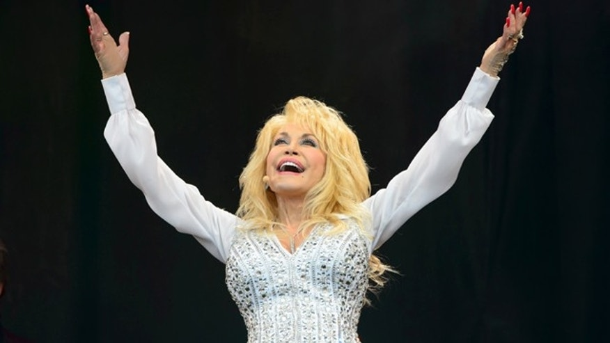 June 29, 2014: Dolly Parton performs at the Glastonbury music festival in England. (Photo by Jonathan Short/Invision/AP)