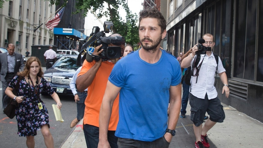 "June 27, 2014. Actor Shia LaBeouf walks through the media after leaving Midtown Community Court following his arrest the previous day for yelling obscenities at the Broadway show ""Cabaret."""