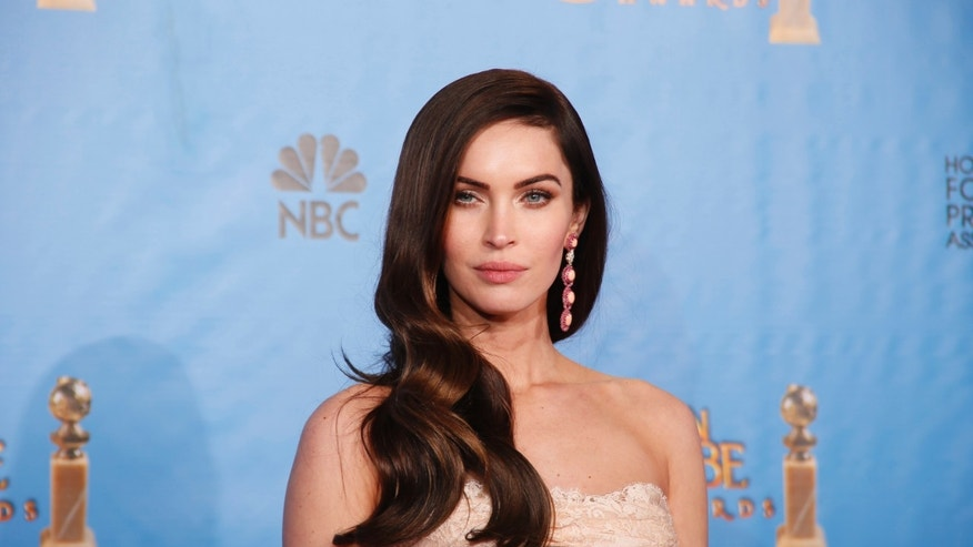 January 13, 2013. Presenter Megan Fox poses backstage at the 70th annual Golden Globe Awards in Beverly Hills, California.