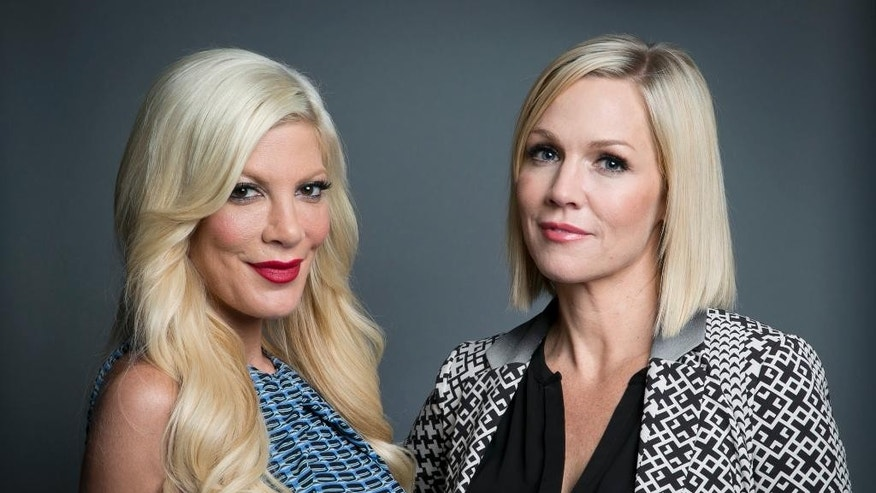 "Original co-stars of the Fox television series ""Beverly Hills, 90210"" actresses Tori Spelling, left, and Jennie Garth, pose for a portrait in promotion of their upcoming ABC Family series ""Mystery Girls"" on Tuesday, June 24, 2014, in New York. (Photo by Amy Sussman/Invision/AP)"