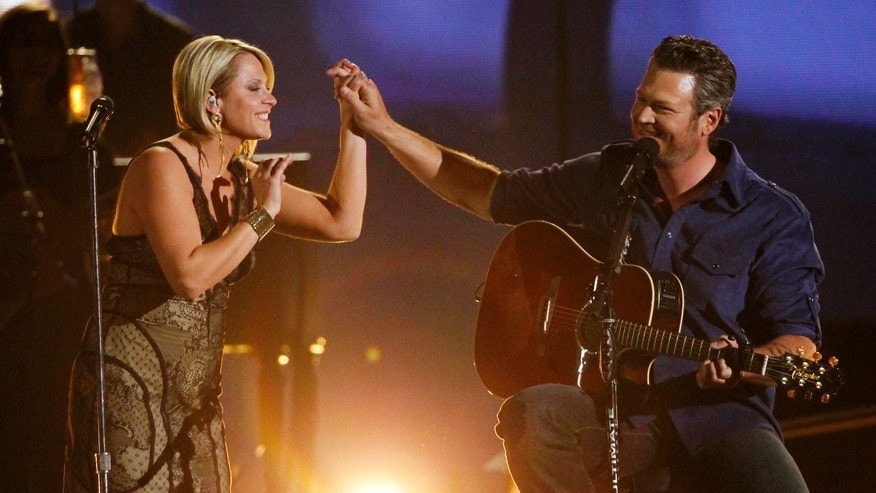 "Gwen Sebastian and Blake Shelton perform ""My Eyes"" at the 49th Annual Academy of Country Music Awards in Las Vegas, Nevada April 6, 2014."