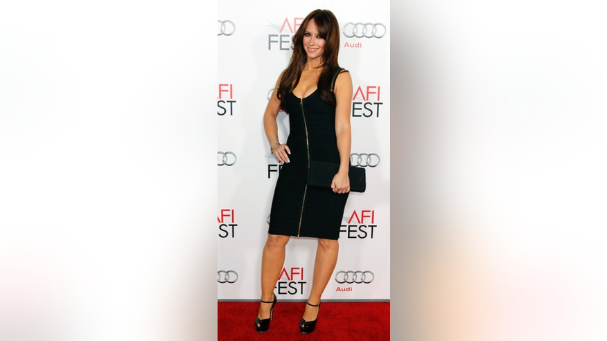 "Actress Jennifer Love Hewitt  poses at the opening night gala for AFI Fest 2011 with the premiere of director Clint Eastwood's film ""J. Edgar""  in Hollywood November 3, 2011. REUTERS/Fred Prouser (UNITED STATES - Tags: ENTERTAINMENT) - RTR2TLHA"
