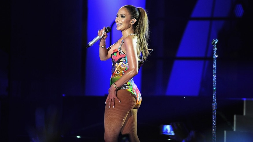 MIAMI BEACH, FL - JUNE 28:  Jennifer Lopez performs onstage at the iHeartRadio Ultimate Pool Party.