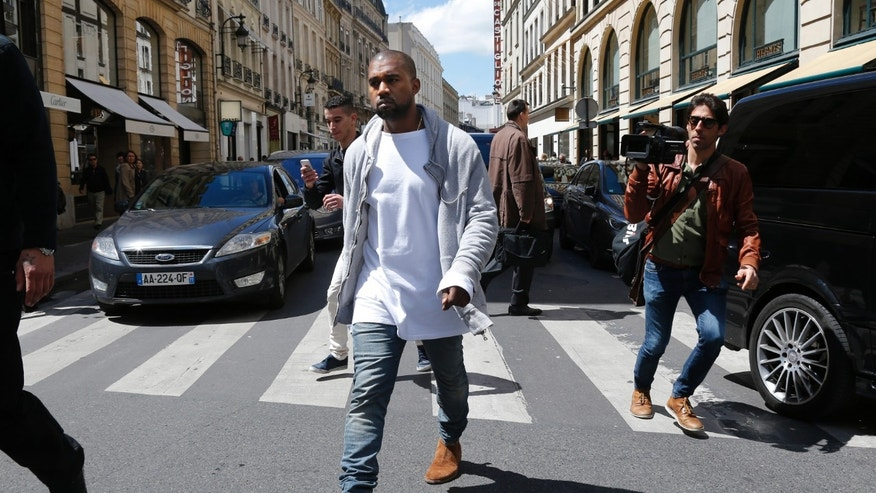 May 22, 2014. Rapper Kanye West  arrives at a fashion designer shop in Paris.