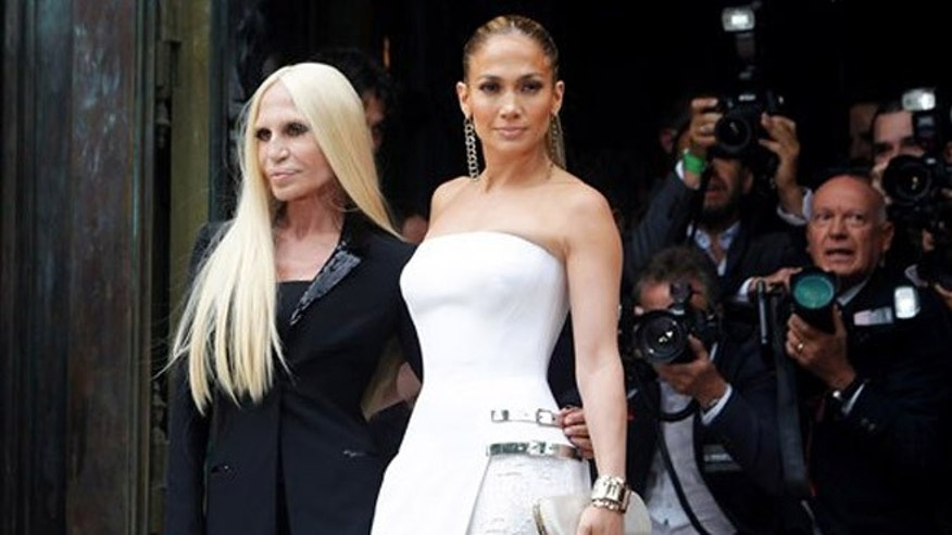 Singer Jennifer Lopez, right, and Italian fashion designer Donatella Versace, pose for photographers prior to the Atelier Versace Fall Winter 2014-15  Haute Couture fashion collection, presented in Paris, Sunday, July 6, 2014. (AP Photo/Thibault Camus)