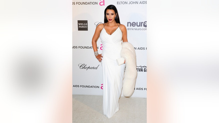 February 24, 2013. TV personality Kim Kardashian arrives at the 2013 Elton John AIDS Foundation Oscar Party in West Hollywood, California.