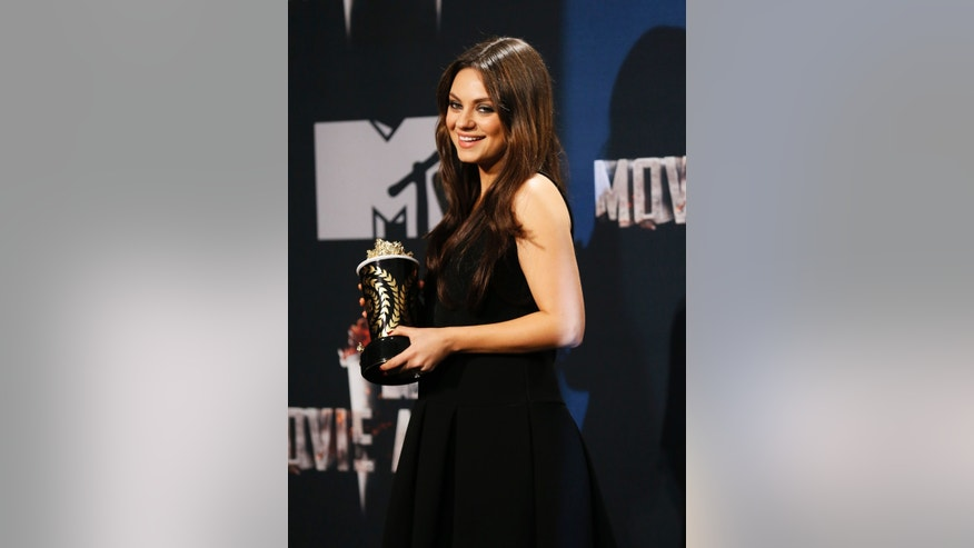 April 13, 2014. Actress Mila Kunis at the MTV Movie Awards in Los Angeles.