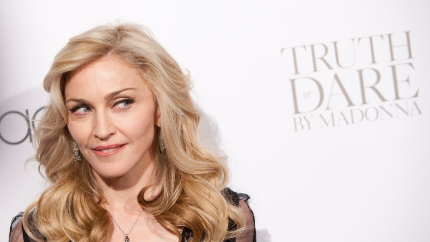 "April 12, 2012. Madonna arrives to the launch of her new fragrance, ""Truth or Dare"" by Madonna at Macy's in New York."