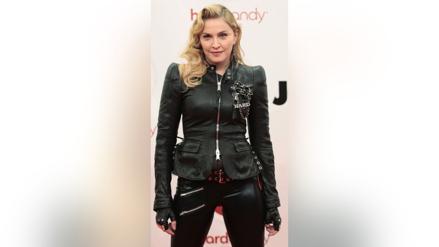 October 17, 2013. Madonna arrives to promote her latest gym in her Hard Candy Fitness center chain in Berlin.