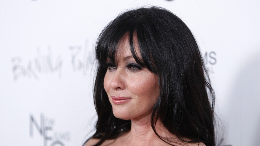 "January 12, 2011. Shannen Doherty poses at the premiere of the film ""Burning Palms"" at the Arclight theatre in Hollywood, California."