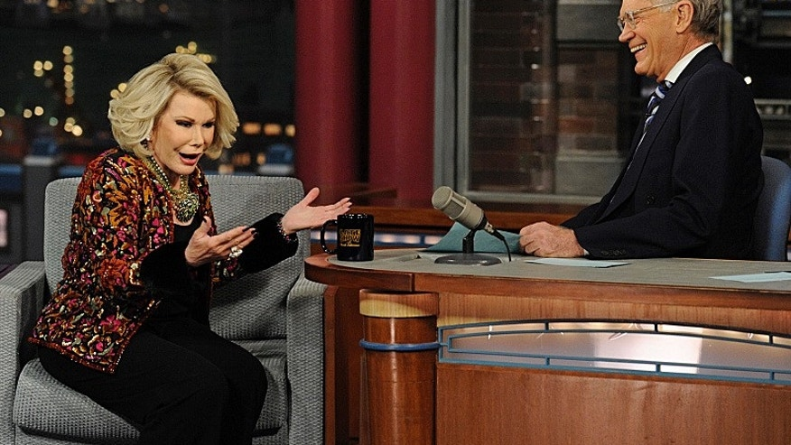 Comedian Joan Rivers shares a laugh with Dave when she visits the Late Show with David Letterman Tuesday Feb. 26, 2013 on the CBS Television Network.
