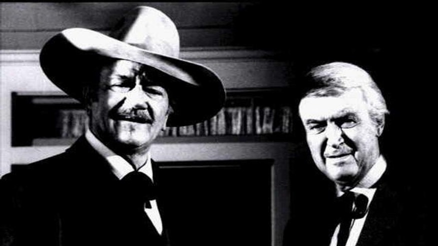 "John Wayne and Jimmy Stewart in scene from movie ""The Shootist."""