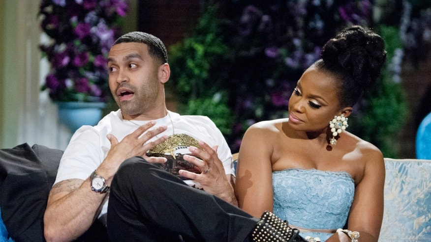 "This 2014 image released by Bravo shows Apollo Nida, left, and his wife Phaedra Parks, cast members on ""The Real Housewives of Atlanta,"" during the taping of a reunion special in Atlanta. Federal prosecutors said Tuesday, July 8, 2014, that 35-year-old Nida has been sentenced to eight years in prison after pleading guilty to federal fraud charges. He was also ordered to pay restitution to victims of a $2.3 million scheme during his sentencing hearing in U.S. District Court in Atlanta. Nida is the husband of Phaedra Parks, one of the reality show's stars. He pleaded guilty May 6 to conspiring to commit mail, wire and bank fraud. (AP Photo/Bravo, Wilford Harewood)"