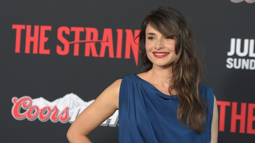 "LOS ANGELES, CA - JULY 10:  Mia Maestro attends the premiere of FX's ""The Strain"" at DGA Theater on July 10, 2014 in Los Angeles, California.  (Photo by Jason Kempin/Getty Images)"