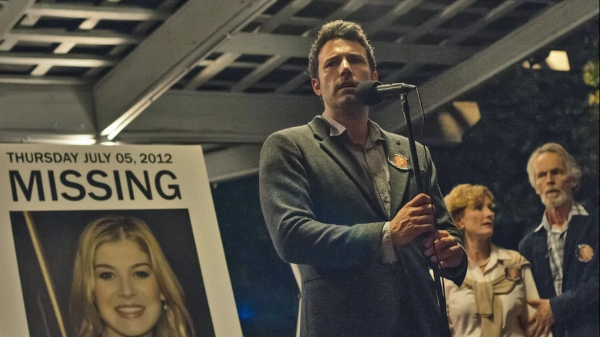 "This image released by 20th Century Fox shows Ben Affleck in a scene from ""Gone Girl."" The film will make its world premiere as the opening night film at the 52nd New York Film Festival. The Film Society of Lincoln Center announced Thursday, July 17, 2014, that the highly anticipated adaption of Gillian Flynns best-selling novel will kick off the festival on September 26. The 20th Century Fox thriller, which stars Ben Affleck and Rosamund Pike, will premiere in theaters shortly after on October 3. (AP Photo/20th Century Fox, Merrick Morton)"