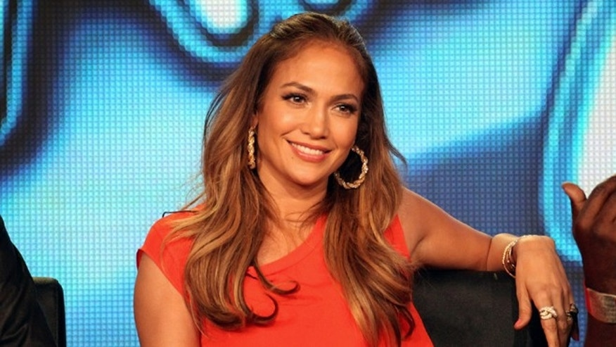 """Judge Jennifer Lopez speaks onstage during the """"American Idol"""" panel during the FOX Broadcasting Company portion of the 2012 Winter TCA Tour at The Langham Huntington Hotel and Spa."""