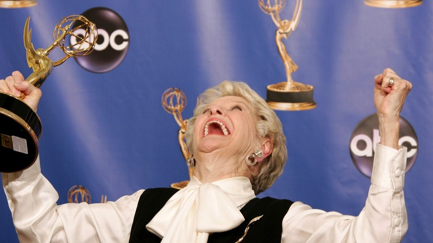 "Elaine Stritch holds her Emmy for outstanding individual performance in a variety or music program, for ""Elaine Stritch: At Liberty,"" while backstage at the 56th annual Primetime Emmy Awards in Los Angeles, September 19, 2004. REUTERS/Lucy Nicholson  FG/SV - RTRB71Q"