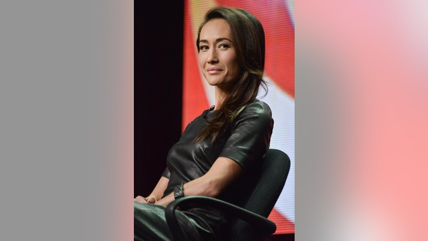 "Maggie Q onstage during the ""Stalker"" panel at the CBS 2014 Summer TCA  held at the Beverly Hilton Hotel on Thursday, July 17, 2014, in Beverly Hills, Calif. (Photo by Richard Shotwell/Invision/AP)"