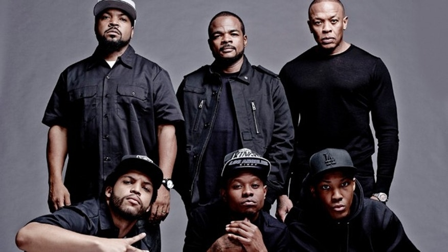 "FILE: This photo released by Universal Pictures shows the cast and filmmakers of ""Straight Outta Compton, "" clockwise, from top left, producer Ice Cube, director F. Gary Gray, producer Dr. Dre, Corey Hawkins (Dr. Dre), Jason Mitchell (Eazy-E) and O'Shea Jackson Jr. (Ice Cube)."