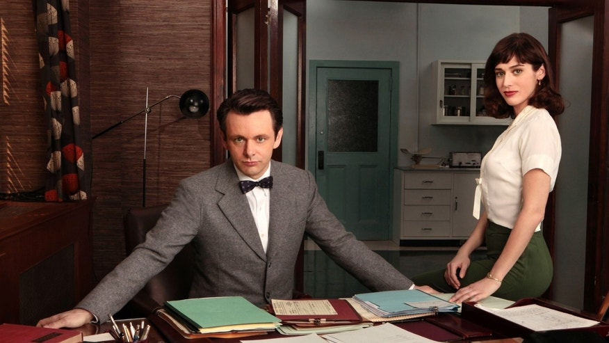 "This publicity image released by Showtime shows Michael Sheen as Dr. William Masters, left, and Lizzy Caplan as Virginia Johnson from ""Masters of Sex."""