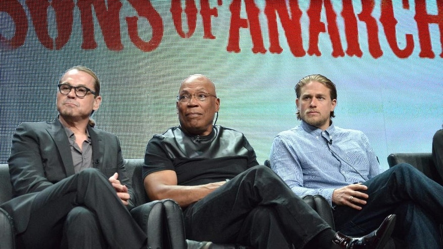 """From left, Creator Kurt Sutter, Director Paris Barclay and actor Charlie Hunnam speak on stage during the """"Sons of Anarchy"""" panel at the The FX 2014 Summer TCA held at the Beverly Hilton Hotel on Monday, July 21, 2014, in Beverly Hills, Calif. (Photo by Richard Shotwell/Invision/AP)"""