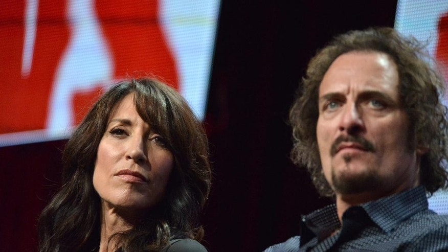 """Katey Sagal, left, and Kim Coates appear on stage during the """"Sons of Anarchy"""" panel at the The FX 2014 Summer TCA held at the Beverly Hilton Hotel on Monday, July 21, 2014, in Beverly Hills, Calif. (Photo by Richard Shotwell/Invision/AP)"""