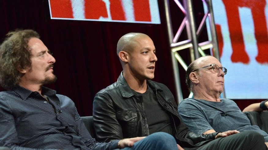 """From left, Kim Coates, Theo Rossi and Dayton Callie speak on stage during the """"Sons of Anarchy"""" panel at the The FX 2014 Summer TCA held at the Beverly Hilton Hotel on Monday, July 21, 2014, in Beverly Hills, Calif. (Photo by Richard Shotwell/Invision/AP)"""
