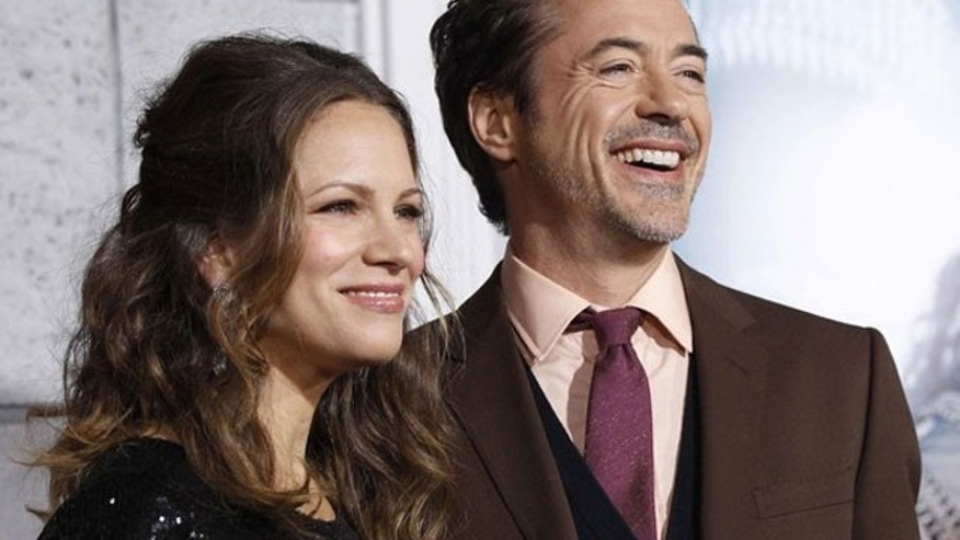 "Dec. 6: Robert Downey Jr and his wife Susan at the L.A. premiere of ""Sherlock Holmes: A Game of Shadows"" at the Village theater. (Reuters)"