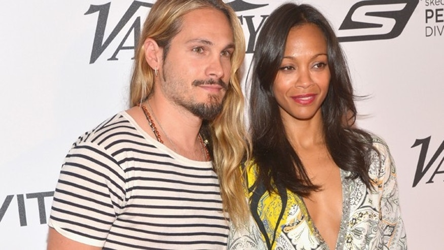 CAP D'ANTIBES, FRANCE - MAY 18:  Marco Perego and Zoe Saldana attend the Relativity at 10 party at Hotel du Cap-Eden-Roc on May 18, 2014 in Cap d'Antibes, France.  (Photo by Michael Buckner/Getty Images for Variety)