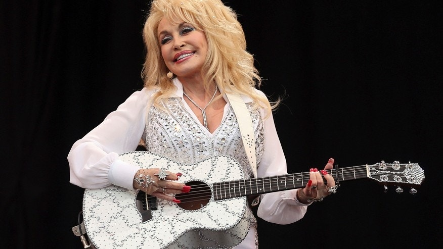 American country music star Dolly Parton performs on the Pyramid Stage at Worthy Farm in Somerset, during the Glastonbury Festival June 29, 2014.