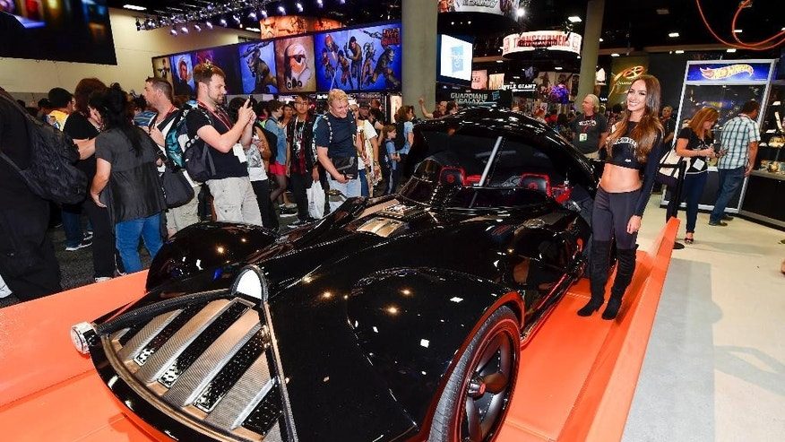 Fans take photos of life sized Hot Wheels Darth Vader Mobile during preview night at the 2014 Comic-Con International Convention held  Wednesday, July 23, 2014 in San Diego. (Photo by Denis Poroy/Invision/AP)