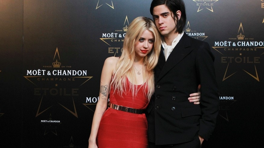 Peaches Geldof and Thomas Cohen pose for photographers at the Moet & Chandon Etoile Award for Mario Testino at the Park Lane Hotel in London, England, September 19, 2011.