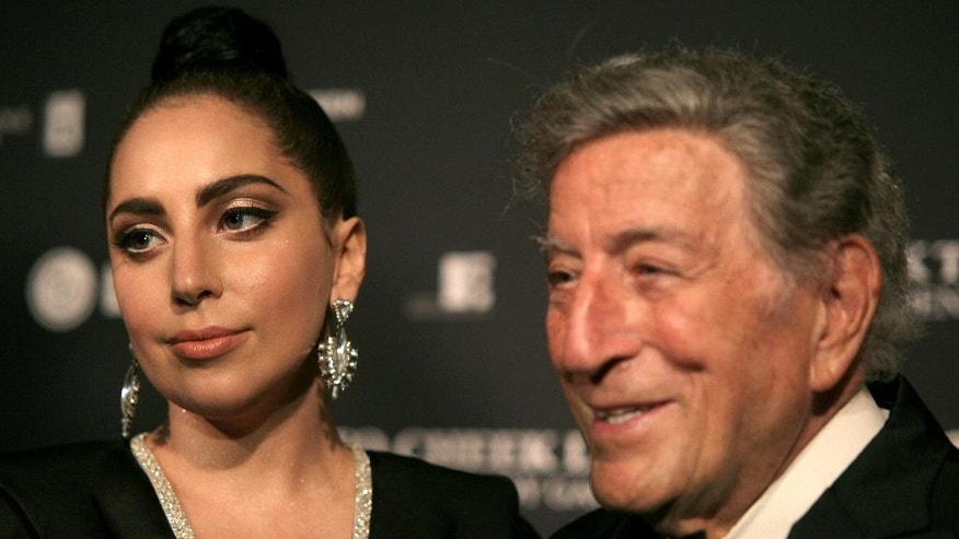 Recording artists Lady Gaga, left, and Tony Bennett, attend a Tony Bennett and Lady Gaga concert taping on Monday, July 28, 2014, in New York. (Photo by Andy Kropa/Invision/AP)