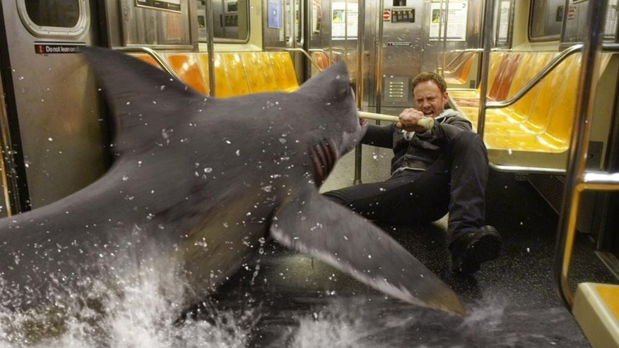 "In this image released by Syfy, Ian Ziering, as Fin Shepard battles a shark on a New York City subway in a scene from ""Sharknado 2: The Second One,"" premiering Wednesday at 9 p.m. EDT. (AP Photo/Syfy)"