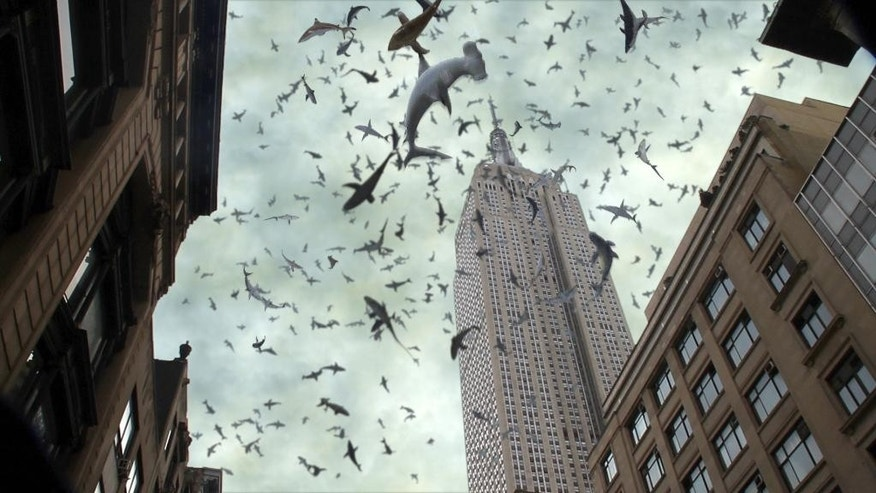 "This image released by Syfy shows a scene from ""Sharknado 2: The Second One,"" premiering Wednesday at 9 p.m. EDT. (AP Photo/Syfy)"