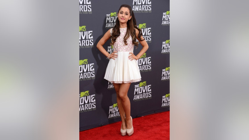 Actress Ariana Grande arrives at the 2013 MTV Movie Awards in Culver City, California April 14, 2013.  REUTERS/Phil McCarten   (UNITED STATES  Tags: Entertainment) (MTV-ARRIVALS) - RTXYLW1