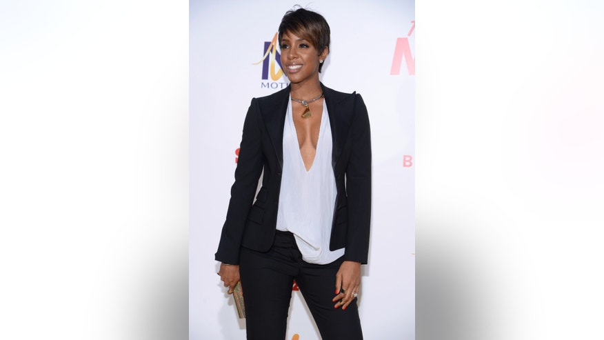 "Kelly Rowland attends the premiere of ""Think Like a Man Too"" in Los Angeles June 9, 2014. REUTERS/Phil McCarten (UNITED STATES - Tags: ENTERTAINMENT) - RTR3SZCA"