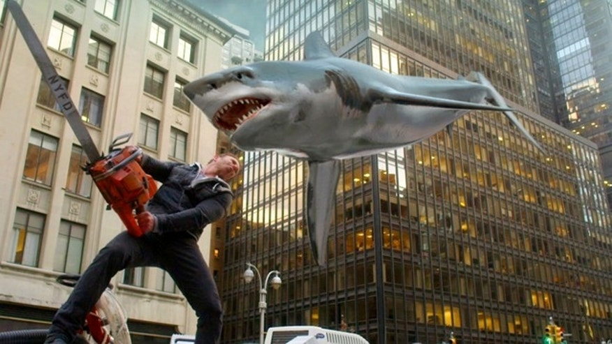 In this image released by Syfy, Ian Ziering, as Fin Shepard, battles a shark on a New York City street in a scene from 'Sharknado 2: The Second One.' (AP Photo/Syfy)
