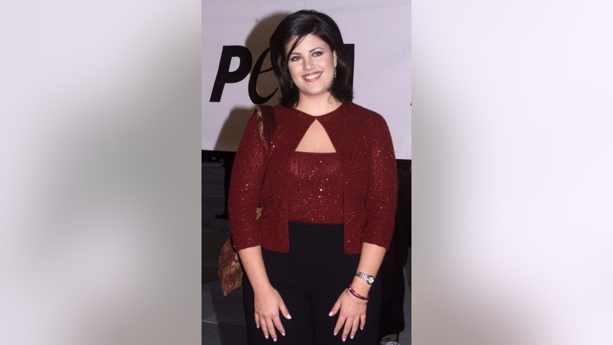 Former White House intern Monica Lewinsky poses as she arrives as a guest for the PETA Party of the Century and Humanitarian Awards on September 18, 1999 at Paramount Studios in Hollywood.