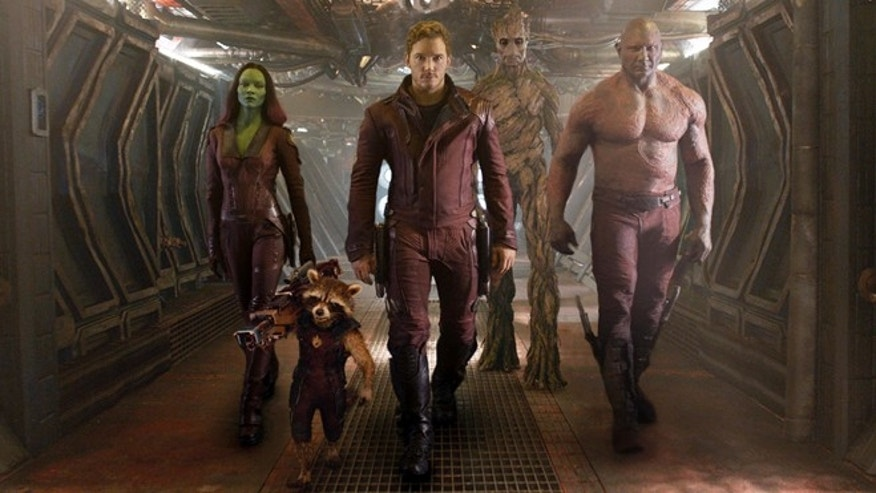 "This image released by Disney - Marvel shows, from left, Zoe Saldana, the character Rocket Racoon, voiced by Bradley Cooper, Chris Pratt, the character Groot, voiced by Vin Diesel and Dave Bautista in a scene from ""Guardians of the Galaxy."" (AP Photo/Disney - Marvel)"