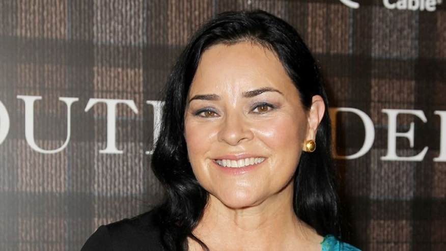 "This July 28, 2014 photo released by Starpix shows author Diana Gabaldon at an event to promote their Starz original series ""Outlander,"" in New York. The series premieres on Aug. 9. (AP Photo/Starpix,  Amanda Schwab)"
