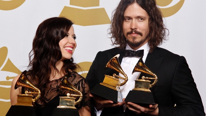 "Joy Williams and John Paul White of The Civil Wars hold their awards for ""Best Country Due/Group Performance and Best Folk Album"" (Barton Hollow) at the 54th annual Grammy Awards in Los Angeles, California, February 12, 2012."