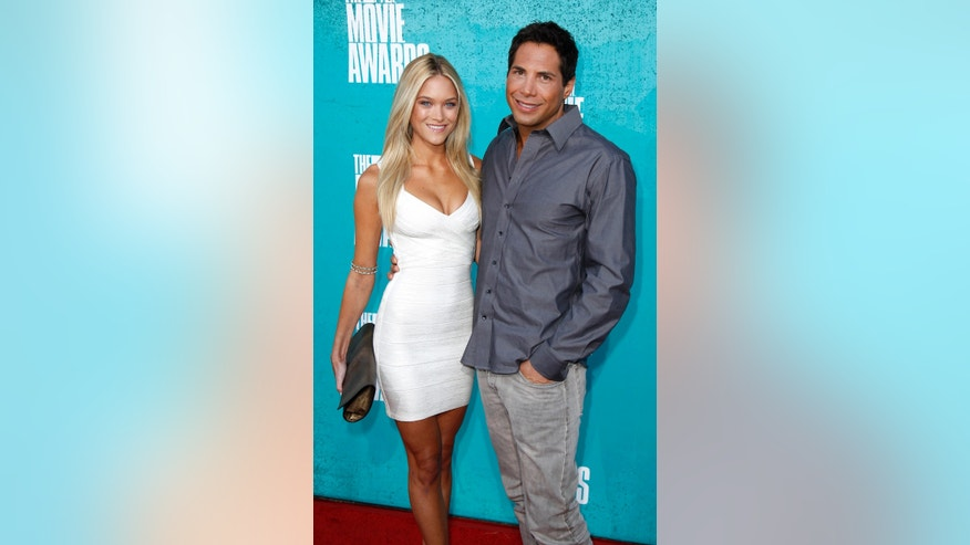 """Girls Gone Wild"" founder Joe Francis and Abbey Wilson arrive at the 2012 MTV Movie Awards in Los Angeles, June 3, 2012."