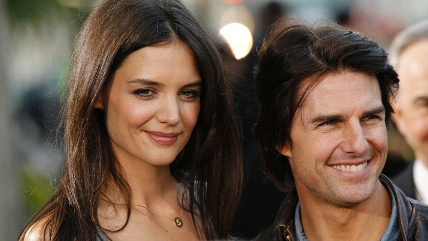 "Actor Tom Cruise posed with his then-wife and cast member Katie Holmes at the premiere of the television series ""The Kennedys"" at the Samuel Goldwyn theatre in Beverly Hills, California March 28, 2011."