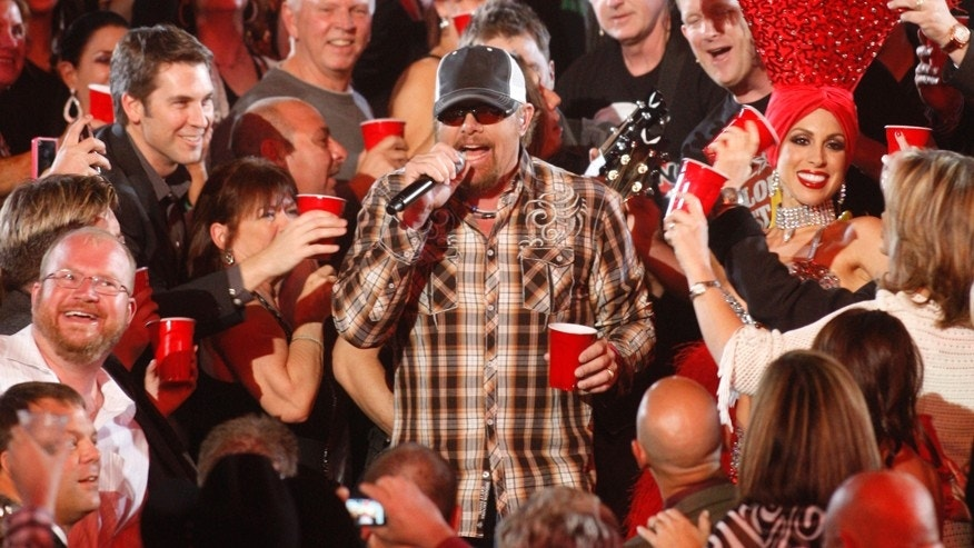 "Toby Keith performs ""Red Solo Cup"" amid the audience at the 47th annual Academy of Country Music Awards in Las Vegas, Nevada, April 1, 2012."