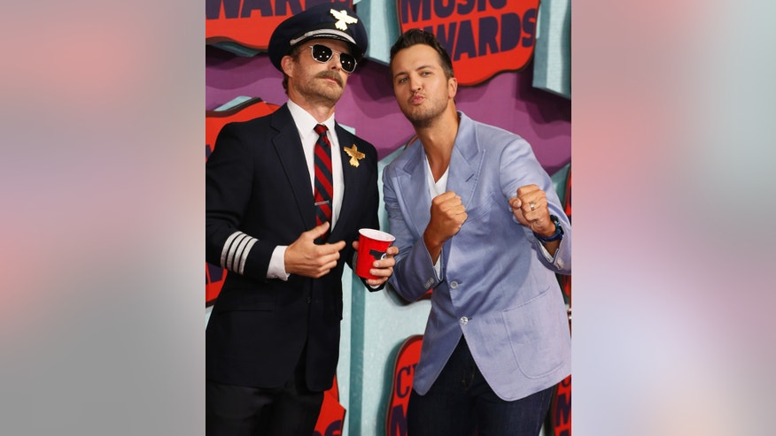 "Country singer Dierks Bentley (L) holds a red solo cup to promote his new single, ""Drunk on a Plane"" with fellow singer Luke Bryan at the 2014 CMT Music Awards in Nashville, Tennessee June 4, 2014."