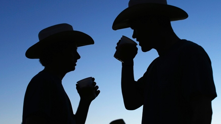 Country music fans drink beer during the final day of the Stagecoach country music festival in Indio, California April  27, 2014.