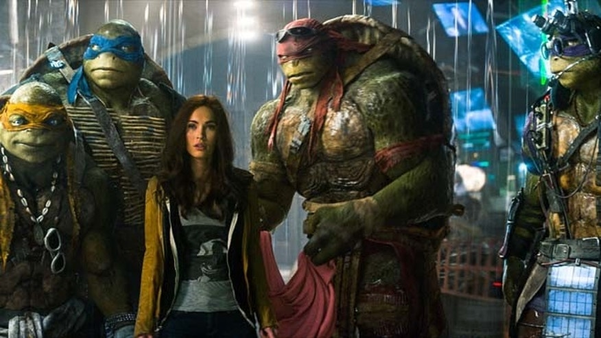 "This image shows, from left, Michelangelo, Leonardo, Megan Fox, as April O'Neil, Raphael, and Donatello in a scene from ""Teenage Mutant Ninja Turtles."" (AP/Paramount Pictures, Industrial Light & Magic)"